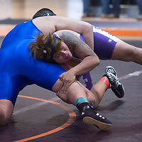 Miyamura Patriot Joshua Ashley attempts to take down  Los Lunas Tiger Justin Ramirez with a single leg attack Wednesday during the Shash Wrestling Duel in Wingate.