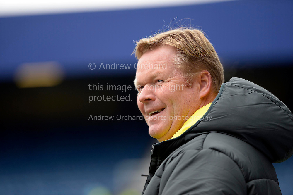 Ronald Koeman, the Southampton manager smiling as he looks on before k/o. Barclays Premier league match, Queens Park Rangers v Southampton at Loftus Road in London on Saturday 7th Feb 2015. pic by John Patrick Fletcher, Andrew Orchard sports photography.