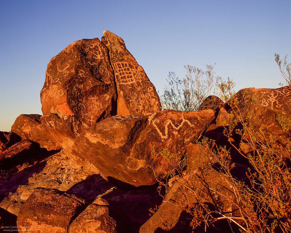 Petroglyphs etched into the rocks at the Painted Rock Petroglyph Site at sunset in the Sonoran Desert of Arizona