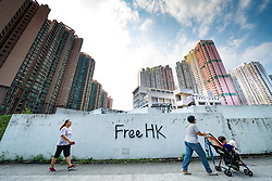 Pro democracy and anti extradition law protest graffiti on wall near housing estates in Ma On Shan in Hong Kong