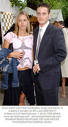 Actor GARY LUCY from footballers wives and friend, at a party in London on 8th June 2002.PAS 71