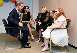 The Duke and Duchess of Sussex meet with Milly Sutherland and her mother Angela during the annual WellChild Awards at the Royal Lancaster Hotel, London.
