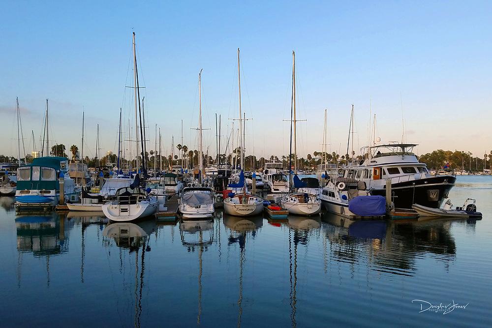 Image of boats docked in Glorietta Bay at sunset in Coronado, CA.