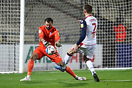 Mark Howard beats Gethin Jones to the ball during the EFL Sky Bet League 2 match between Scunthorpe United and Bolton Wanderers at the Sands Venue Stadium, Scunthorpe, England on 24 November 2020.