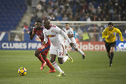 March 1, 2018 - Harrison, New Jersey, United States - New York Red Bulls forward BRADLEY WRIGHT-PHILLIPS (99) brings the ball for a shot on goal defended by Club Deportivo Olimpia Defender JOHNNY PALACIOS (30) during the CONCACAF Champions league match at Red Bull Arena in Harrison, NJ.  NY Red Bulls defeat CD Olimpia 2-0  (Credit Image: © Mark Smith via ZUMA Wire)