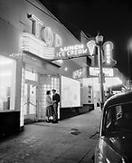 Y-520324. Night photography class at Pacific University. Forest Grove. March 24, 1952. At the Tip Top lunch & ice cream, 2032 Pacific Ave. Next to Grove Theater, 2028 Pacific Ave. (no model release)