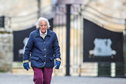 Margaret Evans an 81 years old retired teacher who started teaching when she was 21 in Bamburgh is seen out for a walk in the city on Wednesday, March 17, 2021.