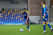 AFC Wimbledon defender Nesta Guinness-Walker (18) about to cross the ball during the EFL Sky Bet League 1 match between AFC Wimbledon and Milton Keynes Dons at Plough Lane, London, United Kingdom on 30 January 2021.