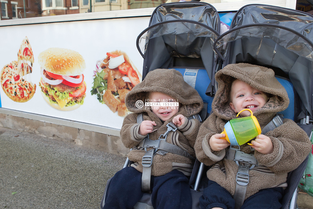 Twins in buggy outside chip shop. (This photo has extra clearance covering Homelessness, Mental Health Issues, Bullying, Education and Exclusion, as well as the usual clearance for Fostering & Adoption and general Social Services contexts,)