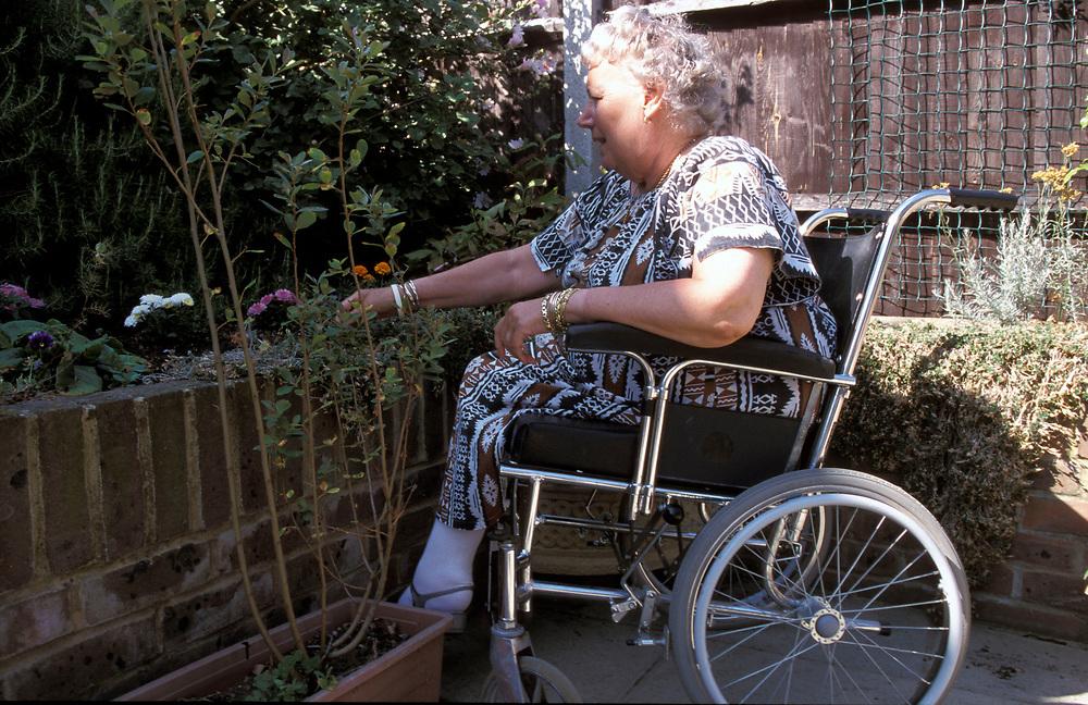 Woman in wheelchair doing her gardening,