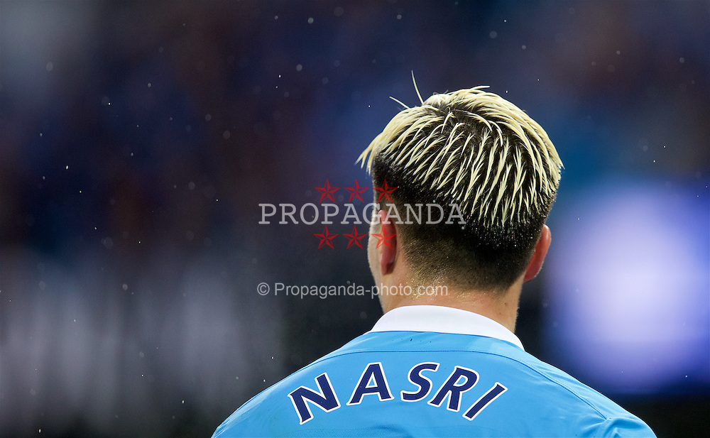 MANCHESTER, ENGLAND - Saturday, April 9, 2016: Manchester City's Samir Nasri, sporting a new dyed blonde hairstyle during the Premier League match against West Bromwich Albion at the City of Manchester Stadium. (Pic by David Rawcliffe/Propaganda)