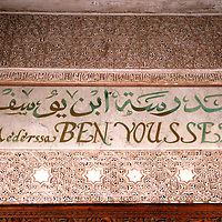 North Africa, Morocco, Marrakesh. Inscription over the entry of the Ben youssef Madrassa, a center for Islamic studies, the largest in Morocco.