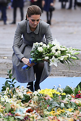 The Duchess of Cambridge lays flowers at the tribute site near to Leicester City Football ClubÕs King Power Stadium, during a visit to Leicester to pay tribute to those who were killed in the helicopter crash last month.