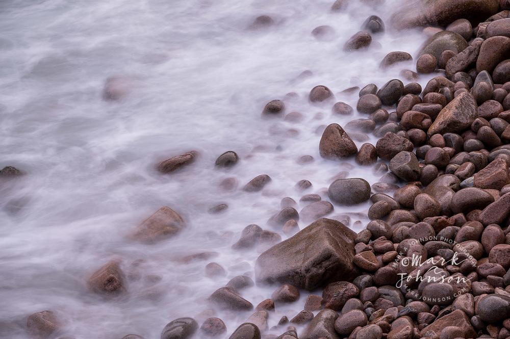 Waves wash up on Boulder Beach, Acadia National Park, Maine, New England, USA