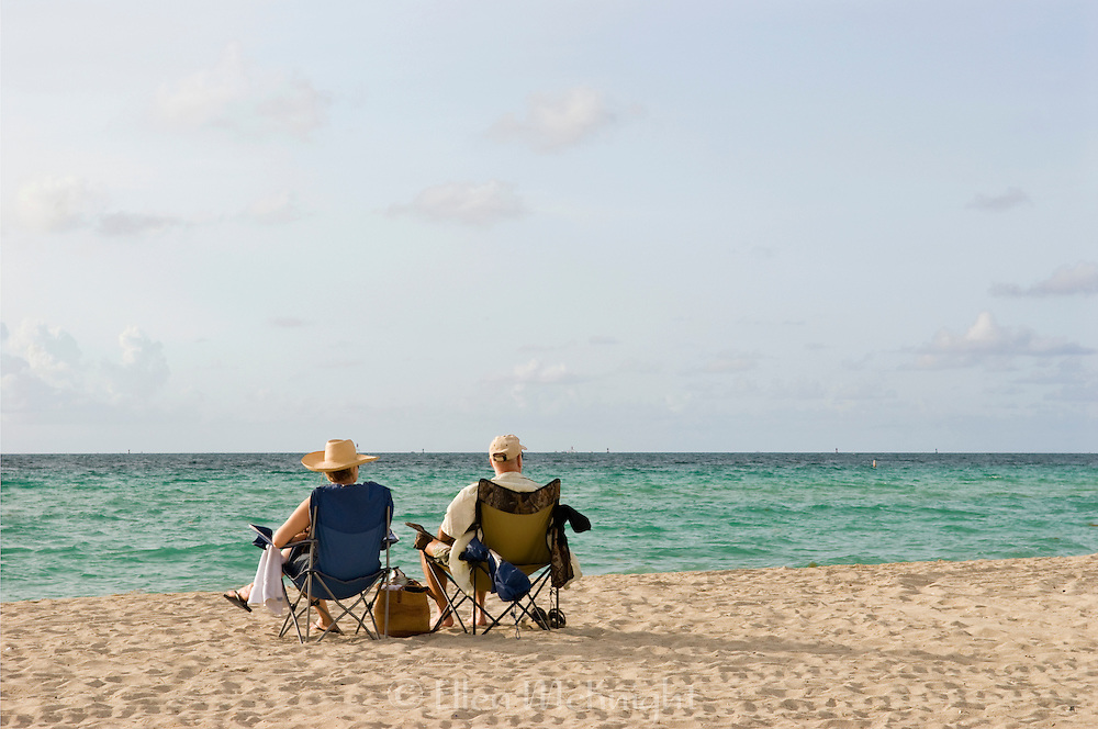 Couple relaxing on Miami Beach in the morning, Florida