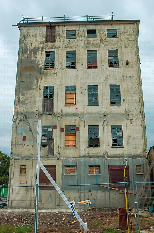 Abandoned factory building with broken windows