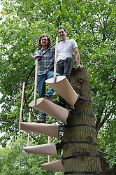 © London News Pictures. 23/06/15. London, UK. From L to R: Thor Ter Kulve and Rob Featherstone McIntyre stand on their installation 'Canopy Stair' which is in the Royal College of Art Graduate Exhibition 2015, Central London. Photo credit: Laura Lean/LNP