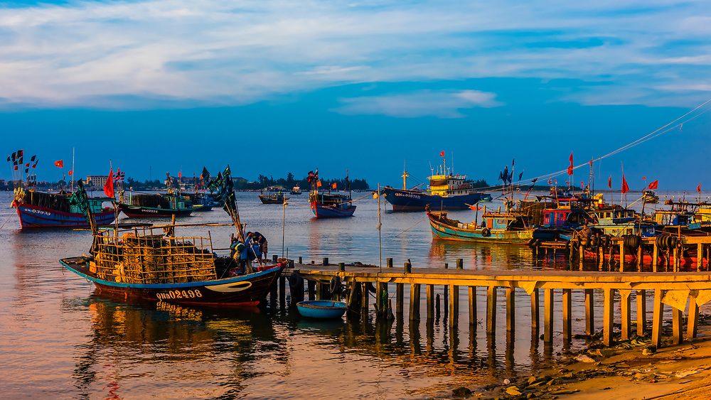 Fishing boats in the village of Tra Nhieu on the Thu Bon River near Hoi An, Vietnam.