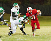 #31 Nathan Croslin sheds the tackle from the Seminoles defense. - Nicholas Rutledge / For The Transcript