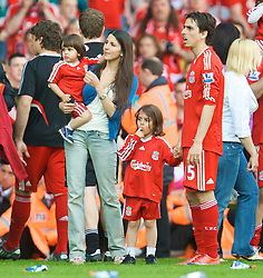 LIVERPOOL, ENGLAND - Sunday, May 24, 2009: Liverpool's Yossi Benayoun with his wife Mirit Ben Yosef with his daughter May on the pitch after the final Premiership match of the season at Anfield. (Photo by: David Rawcliffe/Propaganda)