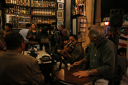 August 4, 2017 - Rio De Janeiro, Brazil - In the city of Rio de Janeiro, traditional businesses in the gastronomy sector are protected by municipal law. One of the examples is Armazem Senado, a traditional bar founded in 1907 by Portuguese immigrants where until today it maintains the same atmosphere of the time of its foundation. The family that currently manages the place is also of Portuguese descent. In the warehouse are sold hundreds of options of drinks, snacks typical of the old bars of the city. On Fridays a traditional samba wheel is performed and the place is crowded. On  August 05, 2017, Rio de Janeiro, Brazil: (Credit Image: © Luiz Souza/NurPhoto via ZUMA Press)