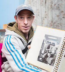 Wayne Bolley, nephew of the late Joyce Rose, a former tea lady at at the BBC who gave bosses the idea for Children In Need, goes through one of his aunt's photo albums. London, November 14 2018.