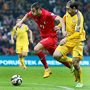 Turkey's Burak Yilmaz (L) during their UEFA Euro 2016 qualification Group A soccer match Turkey betwen Kazakhstan at AliSamiYen Arena in Istanbul November 16, 2014. Photo by Kurtulus YILMAZ/TURKPIX