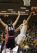 December 29 2010: Iowa Hawkeyes guard/forward Eric May (25) puts up a shot past Illinois Fighting Illini center Mike Tisdale (54) during the first half of an NCAA college basketball game at Carver-Hawkeye Arena in Iowa City, Iowa on December 29, 2010. Illinois defeated Iowa 87-77.