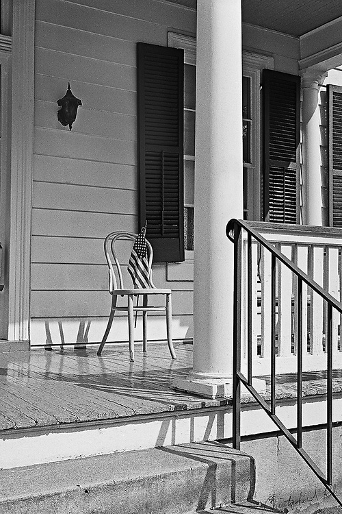 A patriotic porch photographed on the 4th of July.