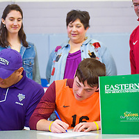 032013       Cable Hoover<br /> <br /> Miyamura Patriot Jared Payton, center, is surrounded by his family and coaches as he signs a letter of intent to play soccer for Eastern New Mexico University Wednesday at Miyamura High School.