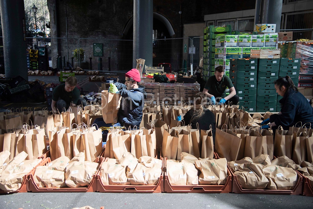 Staff from Turnips greengrocers of Borough Market prepare home deliverys of fruit and vegatable for customers who have ordered online on 6th April 2020 in London, United Kingdom. There have been almost 50,000 reported cases of the COVID-19 coronavirus in the United Kingdom and almost 5,000 deaths. The country is in its third week of lockdown measures aimed at slowing the spread of the virus.