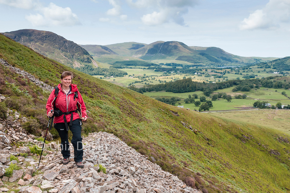 Walker on contouring path on Grasmoor above Liza Beck towards Carling Knott and Loweswater.