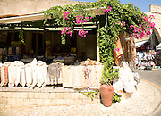 Linen shop and bougainvillea flowers, Rhodes town, Rhodes, Greece