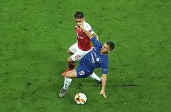 Arsenal's Lucas Torreira (left) and Chelsea's Eden Hazard battle for the ball during the UEFA Europa League final at The Olympic Stadium, Baku, Azerbaijan.