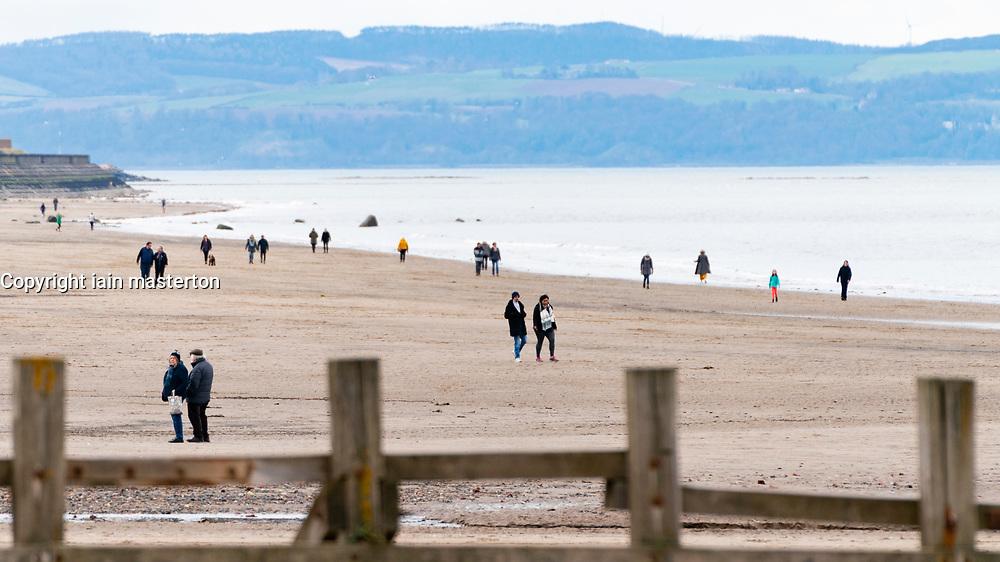 Edinburgh, Scotland, UK. 31 March, 2020. Despite Coronavirus lockdown members of the public are outside exercising and relaxing on Portobello promenade and beach in Edinburgh. Iain Masterton/Alamy Live News