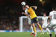 Granit Xhaka of Arsenal and Luca Zuffi of FC Basel compete for the ball. UEFA Champions league group A match, Arsenal v FC Basel at the Emirates Stadium in London on Wednesday 28th September 2016.<br /> pic by John Patrick Fletcher, Andrew Orchard sports photography.
