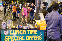 © Licensed to London News Pictures . 15/06/2014 . Manchester , UK . People on a night out in Manchester City Centre overnight , following England's defeat to Italy in the World Cup . Photo credit : Joel Goodman/LNP