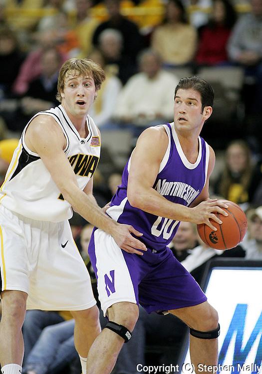 15 FEBRUARY 2007: Iowa guard Adam Haluska (1) guards Northwestern guard/foward Tim Doyle (00) in Iowa's 66-58 win over Northwestern at Carver-Hawkeye Arena in Iowa City, Iowa on February 15, 2007.