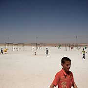 August 09, 2013 - Zarqa, Jordan: Syrian children enjoy the playground of Mrigb Al-Fuhud refugee camp, also known as Emirates-Jordanian camp, 20 kilometres east of the Jordanian city of Zarqa.<br /> The 10 million USD camp, which has 750 caravans, a hospital, and a school and can take up to four thousand people, first opened in April 2013 and was paid for by the United Arab Emirates. Work is underway to house a total of 20 thousand by the end of the year. <br /> In contrast with the two other camps in the area, Mrigb Al-Fuhud as been classified by many as a 'five star' camp due to impressive housing facilities provided to the refugees. (Paulo Nunes dos Santos/Al Jazeera)