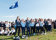 New York, New York  - Members of the Columbia University women's cross country team celebrate after winning the Ivy League Heptagonal cross country championship meet at Van Cortlandt Park in the Bronx on Oct. 26, 2017.