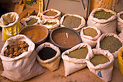 A display of spices and grains in open sacks outside a Berber shop in Morocco, north Africa.