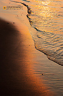 Sunset colors the shoreline at Au Train Bay and Lake Superior near Munising, Michigan, USA