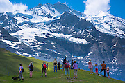 Tourists viewing the Jungfrau mountain peak in the Swiss Alps in Bernese Oberland, Switzerland