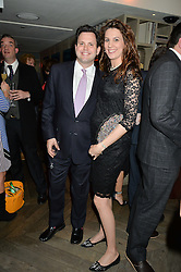HARRY COLE and his sister GEORGINA COLE at the 3rd birthday party for Spectator Life magazine hosted by Andrew Neil and Olivia Cole held at the Belgraves Hotel, 20 Chesham Place, London on 31st March 2015.