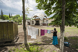 June 2, 2017 - Alashan, Martakert, Nagorno Karabakh - Woman hangs washed clothes in the Alashan refugee camp for relocated civilians of the border Talish village destroyed during the combats between Azerbaijan and Nagorno Karabakh armies. (Credit Image: © Celestino Arce via ZUMA Wire)