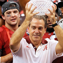 Jan 9, 2012; New Orleans, LA, USA; Alabama Crimson Tide head coach Nick Saban holds up the Coaches Trophy after winning the 2012 BCS National Championship game against the LSU Tigers at the Mercedes-Benz Superdome.  Mandatory Credit: Derick E. Hingle-US PRESSWIRE