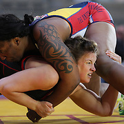 Women wrestlers  Randi Miller, (top), USA,  in action against Alina Makhinya, Ukraine, during the 'Beat The Streets' USA Vs The World, International Exhibition Wrestling in Times Square. New York, USA. 7th May 2014. Photo Tim Clayton