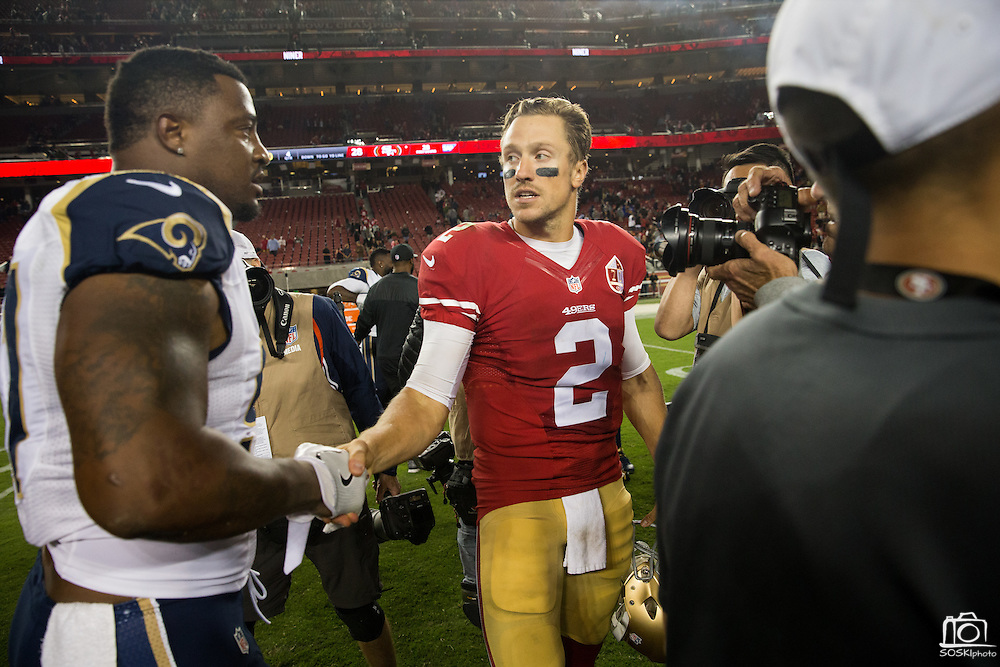 San Francisco 49ers quarterback Blaine Gabbert (2) shakes hands with Los Angeles Rams defensive end Eugene Sims (97) after the 49ers 28-0 win over the Los Angeles Rams at Levi's Stadium in Santa Clara, Calif., on September 12, 2016. (Stan Olszewski/Special to S.F. Examiner)