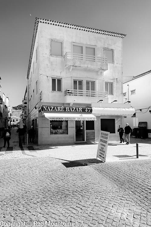Nazaré, Portugal - February 12, 2018 - The Nazaré Bazar 47 souvenir shop along Av. Da Republica.<br /> <br /> Photo: © Rod Mountain<br /> http://bit.ly/RodMountain<br /> <br /> Nazaré, Portugal<br /> https://en.wikipedia.org/wiki/Nazaré,_Portugal