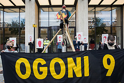 London, UK. 10th November, 2020. Environmental activists from Extinction Rebellion mark the 25th anniversary of the killings of the Ogoni Nine outside the Shell Centre. The Ogoni Nine, leaders of the Movement for the Survival of the Ogoni People (MOSOP) including activist Ken Saro-Wiwa, were executed by the Nigerian government in 1995 after having led a series of peaceful marches involving an estimated 300,000 Ogoni people against the environmental degradation of the land and waters of Ogoniland by Shell and to demand both a share of oil revenue and greater political autonomy.